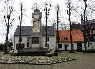 Steyl - Village square with statue of Christ as Verbum Dei. To the left: the ferry and the ferry house. To the right: St. Michael's Monastery