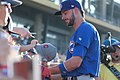 Kris Bryant signing autographs during his rehab assignment against Omaha (44267144072).jpg