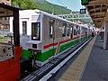 Kurobe Gorge Railway class 3100 passenger coaches at Unazuki Station.jpg