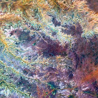 VNIR - A VNIR image of the Ghadamis River in Libya. This is a false-color composite image made using near-infrared, green, and blue wavelengths.