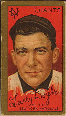 A baseball card of a man in a black and white baseball uniform.