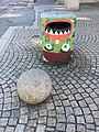 Litter box with grafitti in central Bergen, Norway 2018-03-18. Also cobblestone pavement.jpg