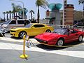 Long Beach Comic Expo 2011 - Ratchet and Bumblebee from Transformers and Magnum PI's Ferrari (5648076623).jpg