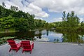 Lounging by the Pond (25320318247).jpg