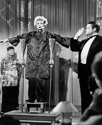 Welles the magician with Lucille Ball in I Love Lucy (October 15, 1956) Lucille Ball Orson Welles I Love Lucy 1956.jpg