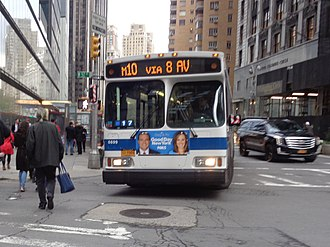 Eighth Avenue Line (Manhattan surface) - An M10 bus entering northbound service at 57th Street in Midtown.