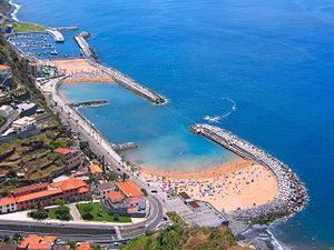 Calheta, Madeira - The manufactured coastal beach of Calheta: replacing the dark rock/sand of the volcanic island with beach sand for tourism