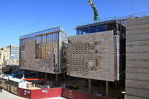 Parliament House (Malta) - Parliament House under construction, with both the steel frame and limestone facade visible
