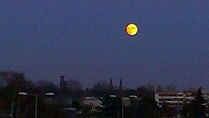 Man in the Moon - Near full moon over Berlin, Germany, approximately 30 minutes after moonrise