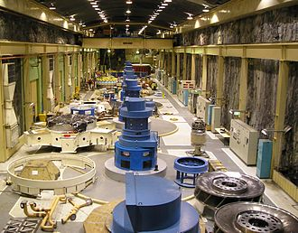 Manapouri Power Station - Photograph showing the turbine hall in October 2006, whilst the power station was undergoing a mid-life refurbishment. Shown on the lower right are two of the Francis Turbine rotors which are ready to be installed in the generators
