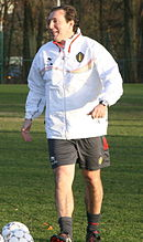 Coach on the pitch in training jacket