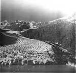 Margerie Glacier, tidewater glacier terminus with wide lateral moraine, August 31, 1977 (GLACIERS 5638).jpg