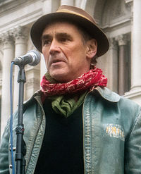 A photograph of Mark Rylance speaking at a Stop the War protest in London in 2015