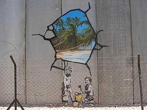 photography of a Banksy graffiti at the Israel...