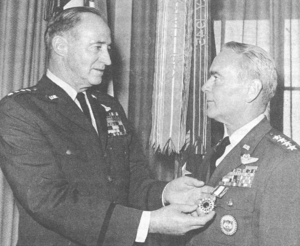 Raymond J. Reeves - Receiving the Distinguished Service Medal from Air Force Chief of Staff John P. McConnell (left), for services while Commander in Chief, Alaskan Air Command.