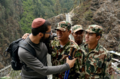 Meir Alfasi at Everest Base Camp with solders.png