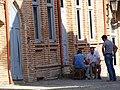 Men in Street - Sighnaghi - Georgia (18125170718).jpg