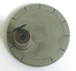 Tradecraft - This Mark IV microdot camera could be used to take pictures of documents. The microdot film was so tiny it could be hidden in a spy's personal effects and smuggled out of a location.