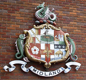 Midland Railway - Midland Railway coat of arms at Derby Station. The wyvern that surmounts it had been used by the Leicester and Swannington Railway. It was the emblem of the rulers of Mercia and was used extensively as an emblem by the Midland.