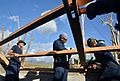 Military Sealift Command crew members assigned to the dry cargo and ammunition ship USNS Charles Drew (T-AKE 10) repair a roof in Ormoc, Philippines, Nov. 16, 2013, while supporting Operation Damayan 131116-N-ZT599-131.jpg