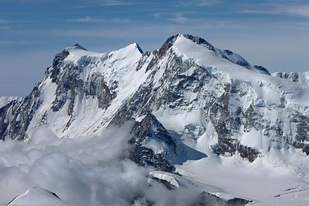 The east and north side with the 600-metre-high (2,000 ft) north face of the Nordend (as seen from the Strahlhorn) Monte Rosa, north side.jpg
