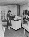 Mrs. Hilbert Bargo, wife of miner, in the kitchen of their three room house which they rent for $6 monthly. Big Jim... - NARA - 541176.tif
