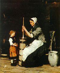 Donna che fa il burro