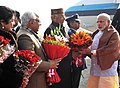 Narendra Modi being received by the Governor of Punjab and Haryana and Administrator, Union Territory, Chandigarh, Prof. Kaptan Singh Solanki and the Chief Minister of Haryana, Shri Manohar Lal Khattar, on his arrival.jpg