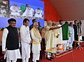 Narendra Modi flagging off the Rajgir-Bihar Sharif-Daniawan-Fatuha passenger train and Patna-Mumbai AC Suvidha Express, at Patna, Bihar. The Governor of Bihar, Shri Keshri Nath Tripathi, the Chief Minister of Bihar.jpg