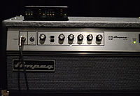 The front control panel of an Ampeg SVT amplifier is shown. Several control knobs are shown.