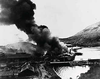 Battle of Dutch Harbor - Barracks ship Northwestern engulfed by flames in Dutch Harbor after the second Japanese airstrike, June 4, 1942