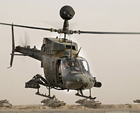 An OH-58D Kiowa Warrior helicopter from the 1s...