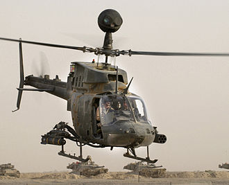 Bell OH-58 Kiowa - An OH-58D Kiowa Warrior takes off armed with an AGM-114 Hellfire and 7 Hydra 70 rockets.