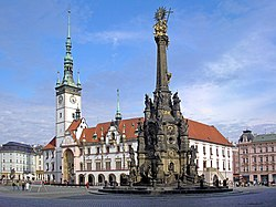 Horní náměstí (Upper Square) — the largest square in Olomouc (on right, the Holy Trinity Column; to the left, the Radnice (Olomouc City Hall) with its astronomical clock)