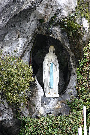 Rosary - Our Lady of Lourdes appearing at Lourdes with rosary beads.