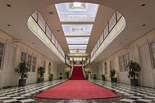 The Red Carpeting And Sky Blue Ceiling Are Hallmarks Of Interior Colonial Style