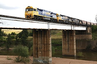 Main North railway line, New South Wales - Pacific National 92 class locomotives hauling a coal train over the Hunter River at Singleton