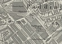 A map showing Paddington mainline station aligned diagonally north-west to south-east amongst streets of houses. Smaller, Metropolitan Railway stations are to the north and south and a goods station is located to the north of all of these