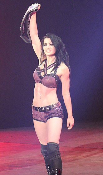 Paige (wrestler) - Paige posing just after winning the Divas Championship at her main roster debut in April 2014