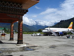 Paro Airport - Drukair Airbus A319-115 parked at the airport terminal at Paro Airport in 2006.