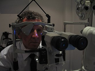 Intraocular pressure - A patient in front of a tonometer