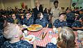 Patricia Adams, deputy assistant secretary of the Navy for civilian human resources, and Capt. Annie B. Andrews, an executive assistant and naval aide, talk with recruits during pizza night at Recruit Training 091001-N-IK959-020.jpg