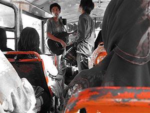 Kopaja - Busker on a Jakarta bus