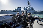 Petty Officers ride in a rigid-hull inflatable boat as they approach the USS Mason. (31494897982).jpg