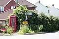 Phone Box and signs at Yeoford - geograph.org.uk - 907350.jpg