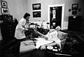 Photograph of First Lady Betty Ford and Her Secretary Nancy Howe Dressing a Skeleton for Halloween in the President's Chair in His Private Study on the Second Floor of the White House - NARA - 6923683.jpg