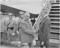 Photograph of President Truman shaking hands with Secretary of State Dean Acheson at the airport in Washington, prior... - NARA - 200118.tif