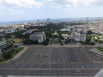 Ministry of the Interior (Cuba) - Panoramic view of Plaza de la Revolución and central Havana – MININT's building is in the left, next to Che Guevara sculpture by Enrique Ávila.