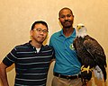 Posing for picture with Bald Eagle. (10594905624).jpg