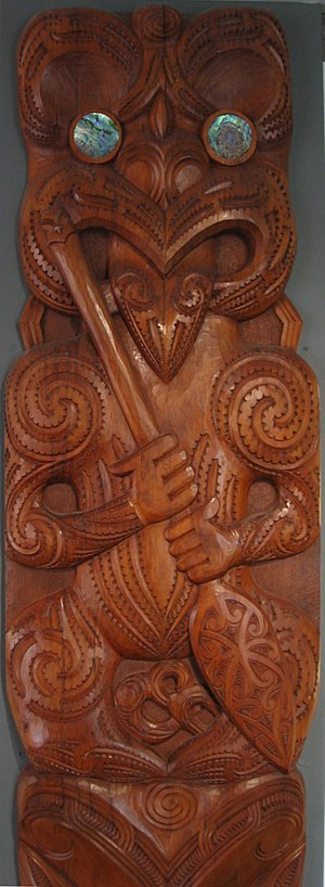 Dowse Art Museum - Detail of a poupou by Rangi Hetet hanging in The Dowse Art Museum. One of a pair of poupou commissioned by the museum on their fifth anniversary in 1975. The poupou are carved wooden figures with inset pāua shell eyes. This figure represents Te Puni.